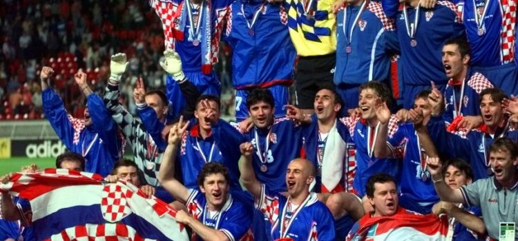 The Croatian soccer team celebrate after winning the soccer World Cup 98 third-place playoff match against the Netherlands 2-1 at the Parc des Princes in Paris Saturday July 11, 1998. (AP Photo/Luca Bruno)